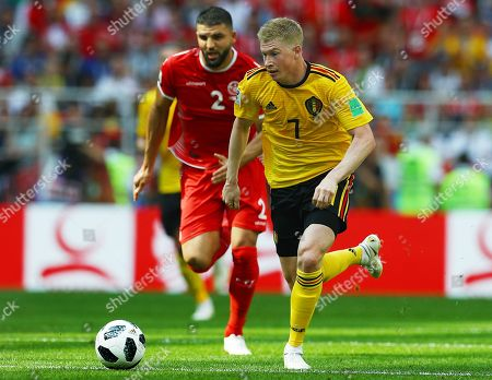 Kevin De Bruyne of Belgium is chased by Syam Ben Youssef of Tunisia of Tunisia