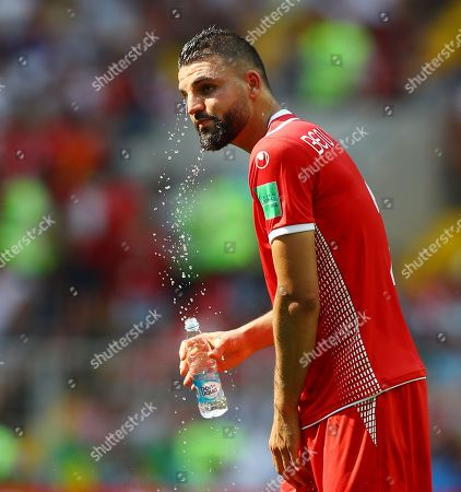 Syam Ben Youssef of Tunisia sprays water