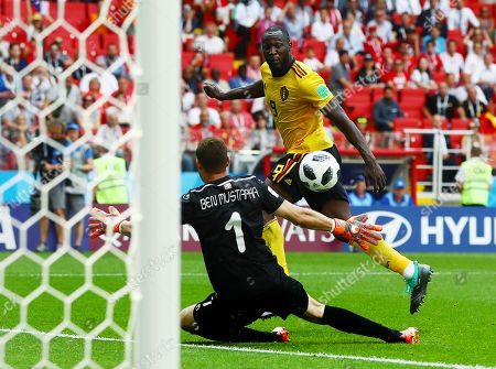 Romelu Lukaku of Belgium scores a goal to make it 3-1 past Tunisia goalkeeper Farouk Ben Mustapha