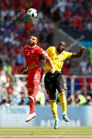 Tunisia's Syam Ben Youssef, left, and Belgium's Romelu Lukaku challenge for the ball during the group G match between Belgium and Tunisia at the 2018 soccer World Cup in the Spartak Stadium in Moscow, Russia