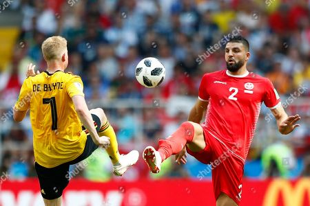 Belgium's Kevin De Bruyne, left, and Tunisia's Syam Ben Youssef challenge for the ball during the group G match between Belgium and Tunisia at the 2018 soccer World Cup in the Spartak Stadium in Moscow, Russia