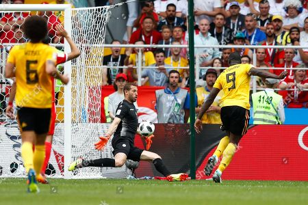 Belgium's Romelu Lukaku, right, scores his side's third goal past Tunisia goalkeeper Farouk Ben Mustapha during the group G match between Belgium and Tunisia at the 2018 soccer World Cup in the Spartak Stadium in Moscow, Russia