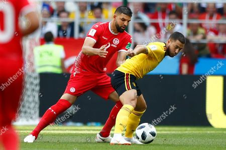 Tunisia's Syam Ben Youssef, left, and Belgium's Eden Hazard challenge for the ball during the group G match between Belgium and Tunisia at the 2018 soccer World Cup in the Spartak Stadium in Moscow, Russia