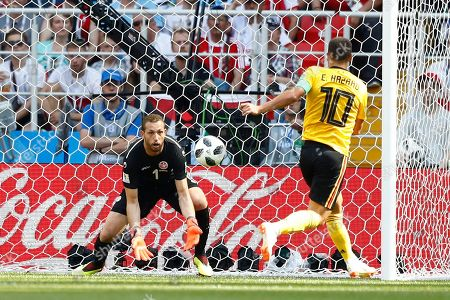 Tunisia goalkeeper Farouk Ben Mustapha, left, stops a kick by Belgium's Eden Hazard during the group G match between Belgium and Tunisia at the 2018 soccer World Cup in the Spartak Stadium in Moscow, Russia