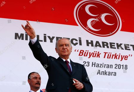 Devlet Bahceli, leader of the Nationalist Movement Party, or MHP, gestures during an election rally in Ankara, Turkey, . Turkish voters will vote Sunday, June 24, in a historic double election for the presidency and parliament