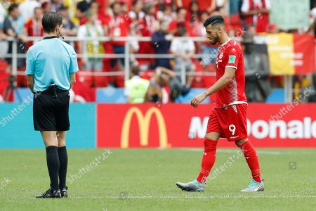 Tunisia's Anice Badri, right, leaves the pitch at the end of the group G match between Belgium and Tunisia at the 2018 soccer World Cup in the Spartak Stadium in Moscow, Russia, . Belgium defeated Tunisia 5-2