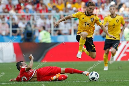 Belgium's Dries Mertens, top, battles for the ball with Tunisia's Syam Ben Youssef during the group G match between Belgium and Tunisia at the 2018 soccer World Cup in the Spartak Stadium in Moscow, Russia