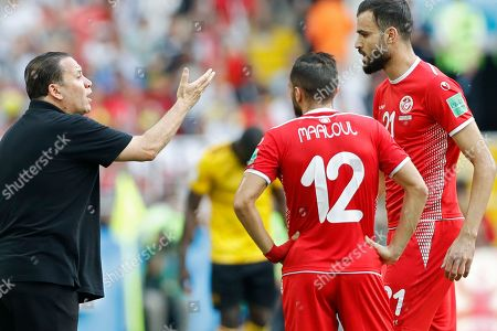 Tunisia head coach Nabil Maaloul, left, talks to his players Ali Maaloul, centre, and Hamdi Naguez during the group G match between Belgium and Tunisia at the 2018 soccer World Cup in the Spartak Stadium in Moscow, Russia