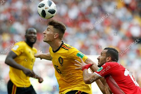 Belgium's Thomas Meunier, left, battles for the ball with Tunisia's Ali Maaloul during the group G match between Belgium and Tunisia at the 2018 soccer World Cup in the Spartak Stadium in Moscow, Russia