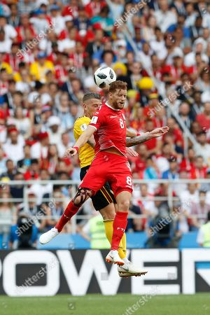 Tunisia's Fakhreddine Ben Youssef, front, goes for a header with Belgium's Toby Alderweireld during the group G match between Belgium and Tunisia at the 2018 soccer World Cup in the Spartak Stadium in Moscow, Russia