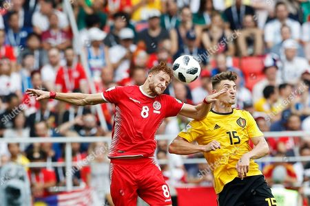 Tunisia's Fakhreddine Ben Youssef, left, goes for a header with Belgium's Thomas Meunier during the group G match between Belgium and Tunisia at the 2018 soccer World Cup in the Spartak Stadium in Moscow, Russia