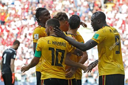 Belgium players celebrate after teammate Romelu Lukaku, right, scored past Tunisia goalkeeper Farouk Ben Mustapha, background left, their team's third goal during the group G match between Belgium and Tunisia at the 2018 soccer World Cup in the Spartak Stadium in Moscow, Russia