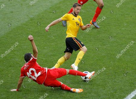 Belgium's Dries Mertens, top, fights for the ball with Tunisia's Ali Maaloul during the group G match between Belgium and Tunisia at the 2018 soccer World Cup in the Spartak Stadium in Moscow, Russia