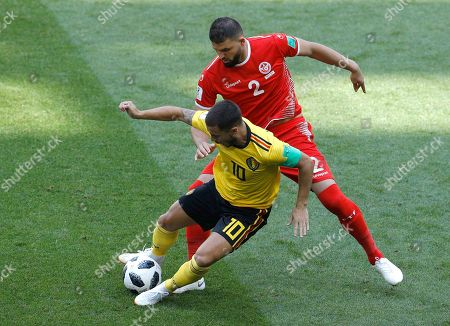 Stock Picture of Belgium's Eden Hazard, foreground, and Tunisia's Syam Ben Youssef battle for the ball during the group G match between Belgium and Tunisia at the 2018 soccer World Cup in the Spartak Stadium in Moscow, Russia