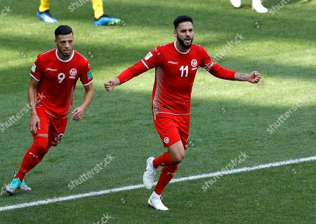 Tunisia's Dylan Bronn, right, scores his side's opening goal against Belgium as Tunisia's Anice Badri follows him during the group G match between Belgium and Tunisia at the 2018 soccer World Cup in the Spartak Stadium in Moscow, Russia