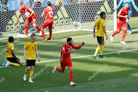 Tunisia's Dylan Bronn, center, scores his side's opening goal against Belgium during the group G match between Belgium and Tunisia at the 2018 soccer World Cup in the Spartak Stadium in Moscow, Russia