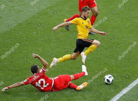 Belgium's Dries Mertens, top, and Tunisia's Ali Maaloul challenge for the ball during the group G match between Belgium and Tunisia at the 2018 soccer World Cup in the Spartak Stadium in Moscow, Russia