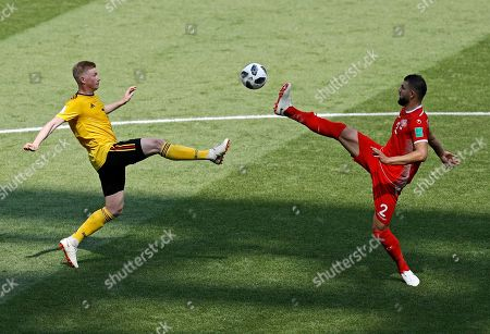 Stock Image of Belgium's Kevin De Bruyne vies for the ball with Tunisia's Syam Ben Youssef vduring the group G match between Belgium and Tunisia at the 2018 soccer World Cup in the Spartak Stadium in Moscow, Russia