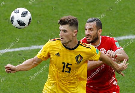 Belgium's Thomas Meunier, foreground, and Tunisia's Ali Maaloul challenge for the ball during the group G match between Belgium and Tunisia at the 2018 soccer World Cup in the Spartak Stadium in Moscow, Russia