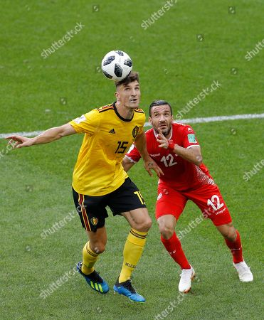 Belgium's Thomas Meunier, left, and Tunisia's Ali Maaloul challenge for the ball during the group G match between Belgium and Tunisia at the 2018 soccer World Cup in the Spartak Stadium in Moscow, Russia