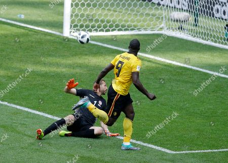 Belgium's Romelu Lukaku, right, scores his side's third goal against Tunisia goalkeeper Farouk Ben Mustapha during the group G match between Belgium and Tunisia at the 2018 soccer World Cup in the Spartak Stadium in Moscow, Russia