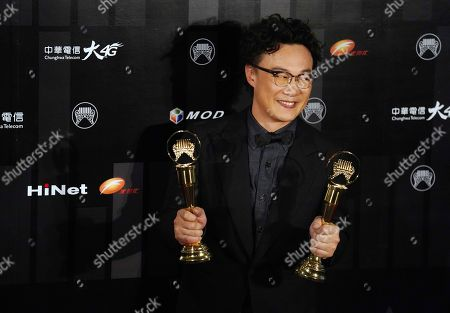 Hong Kong singer Eason Chan holds his awards for the Best Male Mandarin Singer and Best Album at the 29th Golden Melody Awards in Taipei, Taiwan, . The Golden Melody Awards are one of the Chinese-language pop music world's biggest annual events