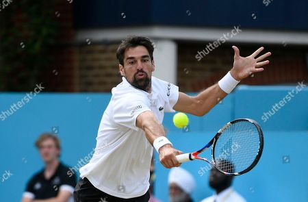 Stock Picture of Jeremy Hardy of France in action against Novak Djokovic of Serbia during their semi final match at the Fever Tree Championship at Queen's Club in London, Britain, 23 June 2018.