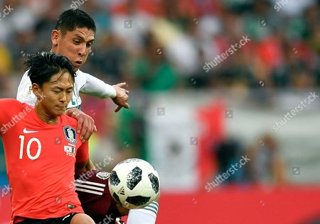 South Korea's Lee Seung-woo, front, duels for the ball with Mexico's Edson Alvarez during the group F match between Mexico and South Korea at the 2018 soccer World Cup in the Rostov Arena in Rostov-on-Don, Russia