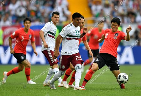 Mexico's Jesus Gallardo, center, duels for the ball with South Korea's Ju Se-jong, right, during the group F match between Mexico and South Korea at the 2018 soccer World Cup in the Rostov Arena in Rostov-on-Don, Russia