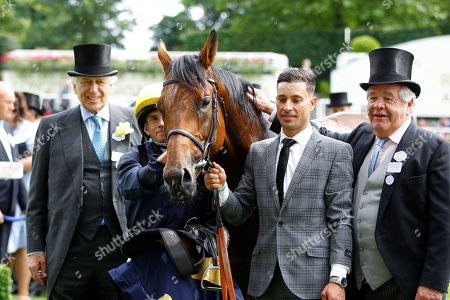 Sir Evelyn de Rothschild with Ryan Moore and Sir Michael Stoute after Crystal Ocean had won the Hardwicke Stakes at Royal Ascot.