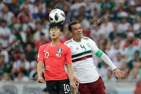 South Korea's Lee Seung-woo, left, and Mexico's Rafael Marquez challenge for the ball during the group F match between Mexico and South Korea at the 2018 soccer World Cup in the Rostov Arena in Rostov-on-Don, Russia
