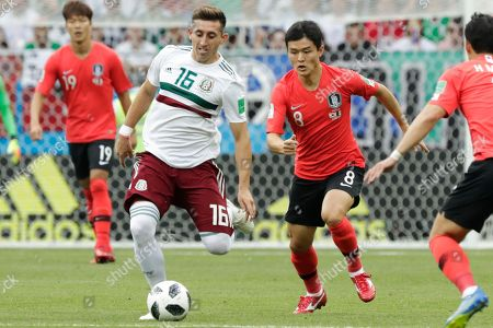Mexico's Hector Herrera, left, and South Korea's Ju Se-jong challenge for the ball during the group F match between Mexico and South Korea at the 2018 soccer World Cup in the Rostov Arena in Rostov-on-Don, Russia