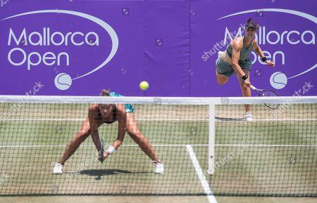 Tennis player Lidziya Marozava (R) of Belarus and Dutch Lesley Kerkhove (L) in action against Czcech Lucie Safarova and Barbora Stefkova (unseen) during their semifinal match of the Mallorca Open WTA tennis tournament at Santa Ponsa Tennis club in Santa Ponsa, Balearic Islands, Spain, 23 June 2018.