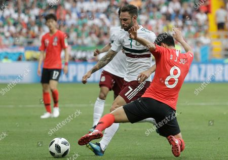 South Korea's Ju Se-jong, right, challenges for the ball with South Korea's Son Heung-min during the group F match between Mexico and South Korea at the 2018 soccer World Cup in the Rostov Arena in Rostov-on-Don, Russia