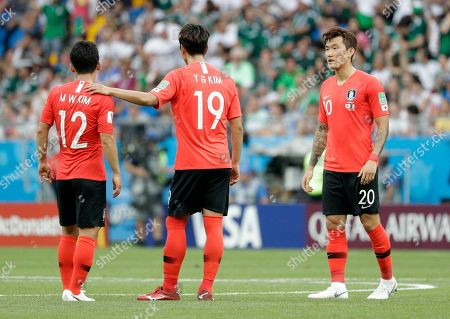 South Korea's Kim Young-gwon, center, Kim Min-woo and Jang Hyun-soo, right, stand on the pitch after Mexico scored the opening goal during the group F match between Mexico and South Korea at the 2018 soccer World Cup in the Rostov Arena in Rostov-on-Don, Russia