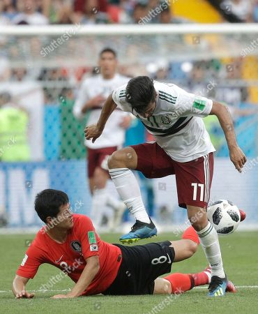 Mexico's Carlos Vela, top, challenges for the ball with South Korea's Ju Se-jong during the group F match between Mexico and South Korea at the 2018 soccer World Cup in the Rostov Arena in Rostov-on-Don, Russia