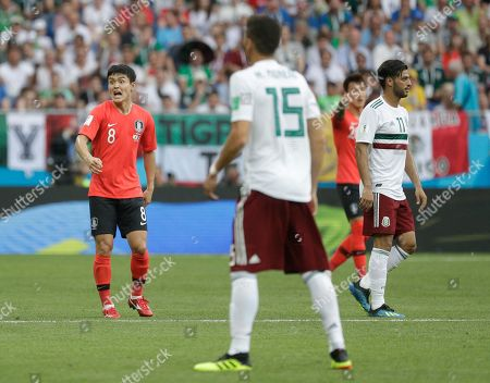South Korea's Ju Se-jong, left, shouts during the group F match between Mexico and South Korea at the 2018 soccer World Cup in the Rostov Arena in Rostov-on-Don, Russia