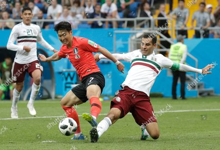 Mexico's Rafael Marquez, right, challenges for the ball with South Korea's Son Heung-min during the group F match between Mexico and South Korea at the 2018 soccer World Cup in the Rostov Arena in Rostov-on-Don, Russia