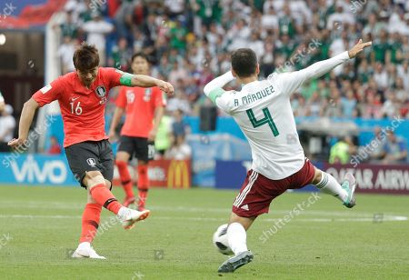 Mexico's Rafael Marquez, right, moves to block a shot by South Korea's Ki Sung-yueng, during the group F match between Mexico and South Korea at the 2018 soccer World Cup in the Rostov Arena in Rostov-on-Don, Russia