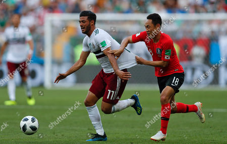 Mexico's Carlos Vela, left, challenges for the ball with South Korea's Moon Seon-min during the group F match between Mexico and South Korea at the 2018 soccer World Cup in the Rostov Arena in Rostov-on-Don, Russia