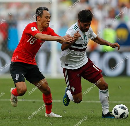 Mexico's Carlos Vela, right, challenges for the ball with South Korea's Moon Seon-min during the group F match between Mexico and South Korea at the 2018 soccer World Cup in the Rostov Arena in Rostov-on-Don, Russia
