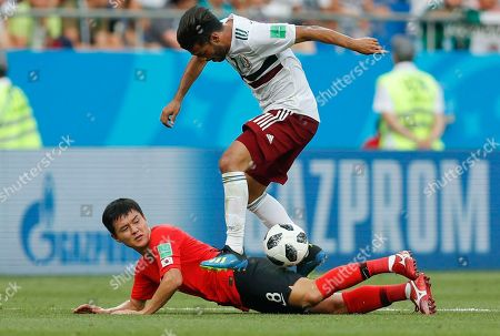 Mexico's Carlos Vela, above, challenges for the ball with South Korea's Ju Se-jong during the group F match between Mexico and South Korea at the 2018 soccer World Cup in the Rostov Arena in Rostov-on-Don, Russia