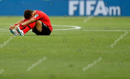 South Korea's Yun Young-sun sits on the pitch at the end of the group F match between Mexico and South Korea at the 2018 soccer World Cup in the Rostov Arena in Rostov-on-Don, Russia