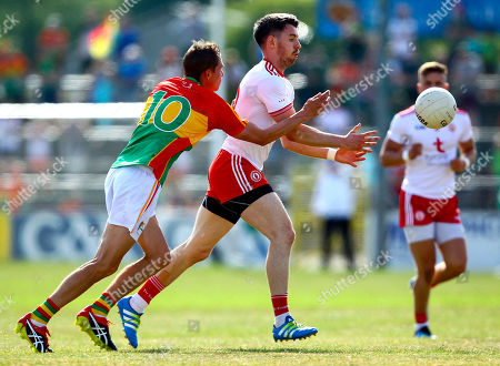 Carlow vs Tyrone. Tyrone's Matthew Donnelly and Carlow's Sean Gannon