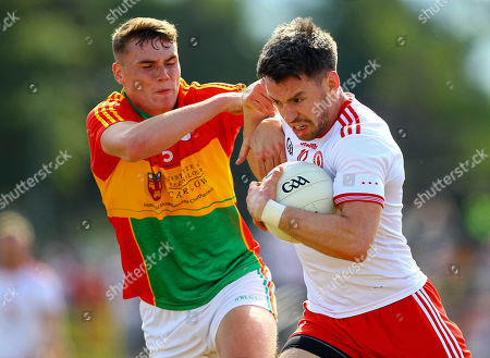 Carlow vs Tyrone. Tyrone's Matthew Donnelly and Carlow's Jordan Morrissey