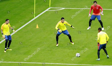 Colombia national team goalkeepers David Ospina (L), Camilo Vargas (C) and Jose Cuadrad (R) during a training session at the Kazan Arena stadium in Kazan, Russia, 23 June 2018. Colombia will face Poland in the FIFA World Cup 2018 Group H preliminary round soccer match  on 24 June 2018.
