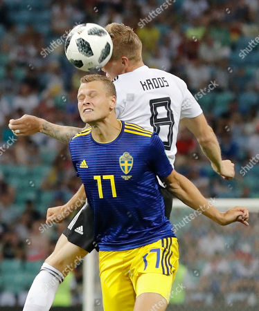 Sweden's John Guidetti, left, and Germany's Toni Kroos jump for the ball during the group F match between Germany and Sweden at the 2018 soccer World Cup in the Fisht Stadium in Sochi, Russia