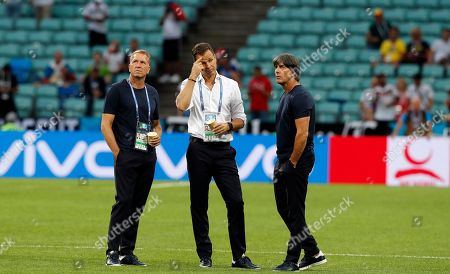 From left, Germany goalkeepers coach Andreas Koepke, team manager Oliver Bierhoff and head coach Joachim Loew stand on the pitch prior to the start of the group F match between Germany and Sweden at the 2018 soccer World Cup in the Fisht Stadium in Sochi, Russia