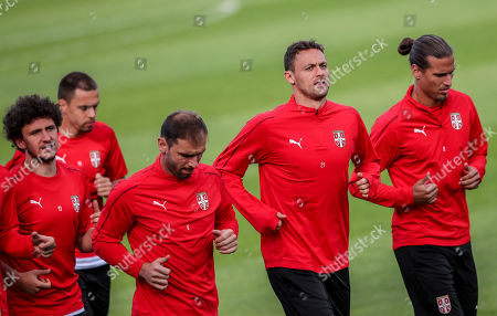 Serbia's Nemanja Matic (C), Aleksandar Prijovic (R) and Branislav Ivanovic (3L) attend a training session of Serbian national soccer team at the training site Baltiya in Svetlogorsk, Russia, 23 June 2018. Serbia will face Brazil in the FIFA World Cup 2018 Group E preliminary round soccer match on 27 June 2018.