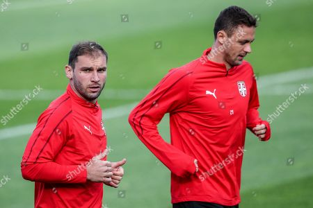Serbia's Nemanja Matic (R) and Branislav Ivanovic (L) during a training session at the team base camp in Baltiya, Svetlogorsk, Kaliningrad region, Russia, 23 June 2018. Serbia will face Brazil in the FIFA World Cup 2018 Group E preliminary round soccer match on 27 June 2018.